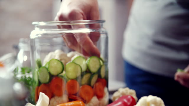 preserving organic vegetables in jars - pickled stock videos and b-roll footage