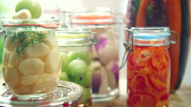 preserving organic vegetables in jars - canning stock videos & royalty-free footage