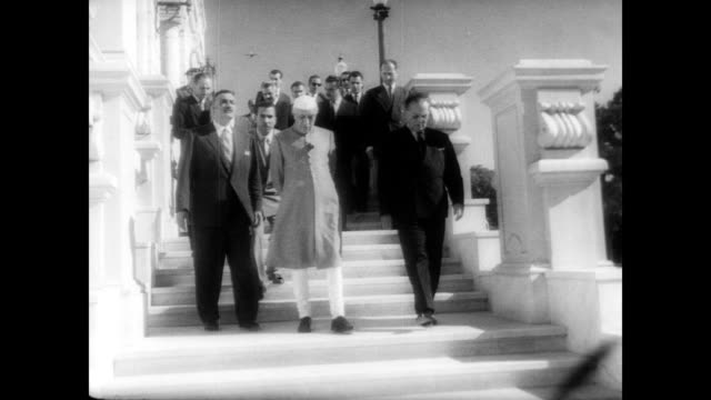 / President Abdul Nasser Marshall Josip Broz Tito and Jawaharlal Nehru on the balcony of Egyptian palace getting ready for conference / Egyptian flag...