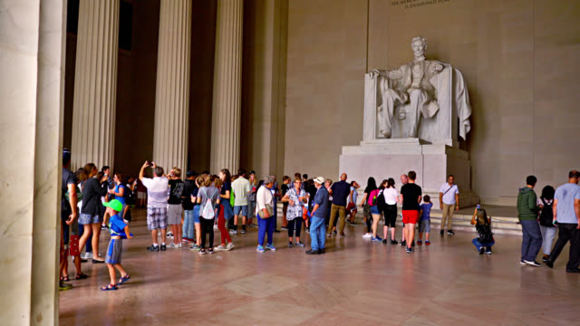 president abraham lincoln memorial. tourists take pictures. historical monument. - politician stock videos & royalty-free footage