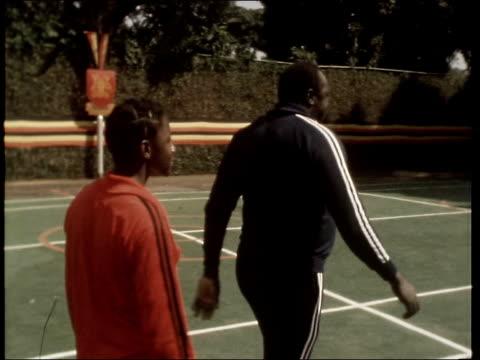 vidéos et rushes de president amin plays basketball with diplomats; uganda: kampala: nakassero lodge gv house pan lawnto helicopter drumming sof cms band sof pan idi... - kampala