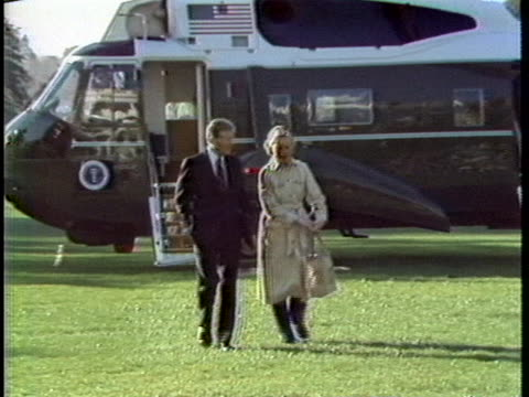 president and mrs. jimmy carter arrive back in washington d. c. from camp david during the u. s. embassy takeover crisis in iran. - jimmy carter us president stock videos & royalty-free footage