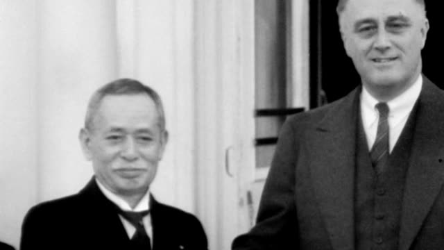 President and Mrs Roosevelt greet Viscount Ishii Kikujiro on steps of White House / FDR standing with cane hangs it on military personnel standing...