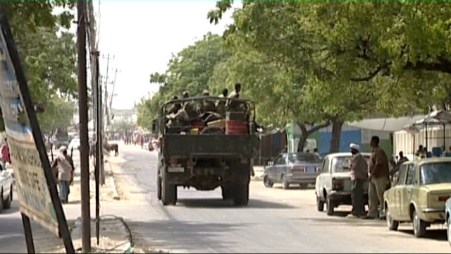 President and Prime Minister attempt to consolidate power / Violence in Mogadishu Truck along with armed soldiers sitting on back People standing in...