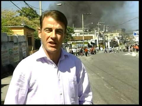 president aristide flees; i/c - itv weekend late news点の映像素材/bロール