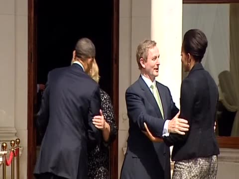 president barack obama and first lady michelle obama meet irish prime minister enda kenny and his wife on their visit to ireland - first lady stock videos & royalty-free footage
