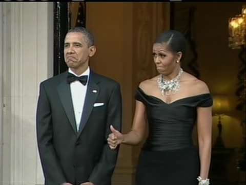 president barack obama and first lady michelle obama standing in the entrance of winfield house where the president is holding a dinner for the... - (war or terrorism or election or government or illness or news event or speech or politics or politician or conflict or military or extreme weather or business or economy) and not usa stock videos & royalty-free footage