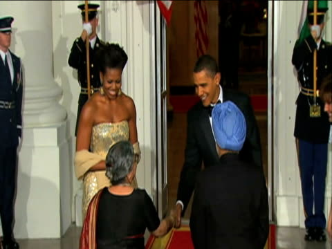 president barack obama and first lady michelle obama welcome indian prime minister manmohan singh and his wife gursharan kaur to state dinner at the... - state dinner stock videos & royalty-free footage