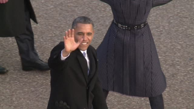 US President Barack Obama and his wife Michelle climbed out of their armored Beast limousine to greet wildly cheering crowds lining the route of the...