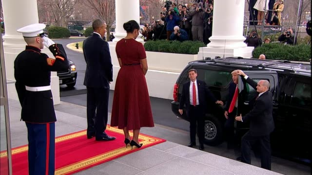 vídeos de stock, filmes e b-roll de president barack obama and michelle obama greet incoming presidentelect donald trump and wife melania who bears a gift for michelle - tomada de posse