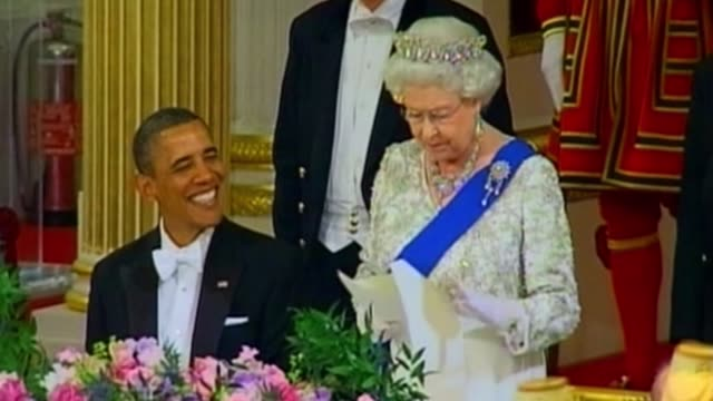 president barack obama and queen elizabeth ii tuesday processed together into a glittering buckingham palace state dinner, and paid history-daubed... - state dinner stock videos & royalty-free footage