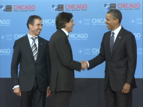 president barack obama and secretary general of nato anders fogh rasmussen greet elio di rupo, prime minister of belgium, at the nato summit in... - united states and (politics or government) stock videos & royalty-free footage