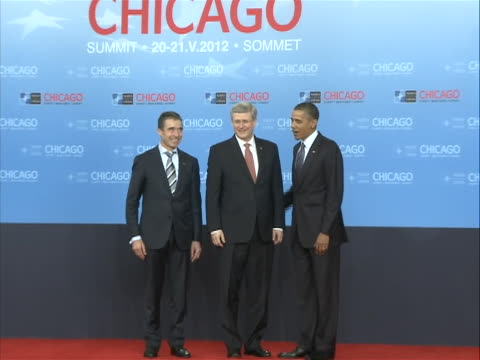 president barack obama and secretary general of nato anders fogh rasmussen greet stephen harper, prime minister of canada, at the nato summit in... - united states and (politics or government) stock videos & royalty-free footage