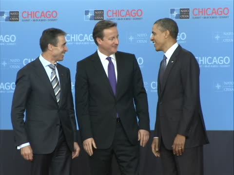 president barack obama and secretary general of nato anders fogh rasmussen greet david cameron, prime minister of great britain, at the nato summit... - united states and (politics or government) stock videos & royalty-free footage