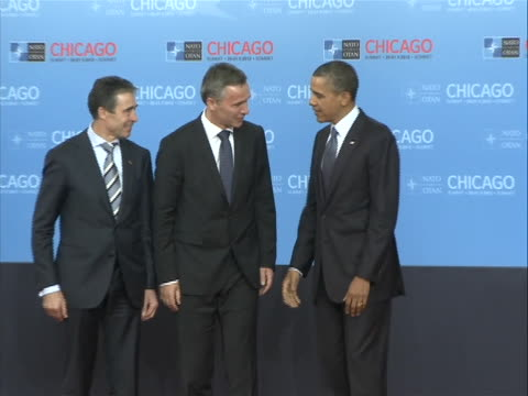 president barack obama and secretary general of nato anders fogh rasmussen greet jens stoltenberg, prime minister of norway, at the nato summit in... - united states and (politics or government) stock videos & royalty-free footage
