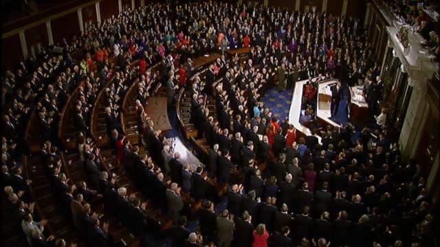 president barack obama begins his speech telling members that he will keep it short joking that presidential candidates must return to iowa says he... - 改革点の映像素材/bロール