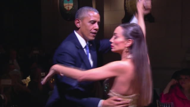 president barack obama dances with a professional tango dancer at state dinner in buenos aires, argentina. - produced segment stock videos & royalty-free footage