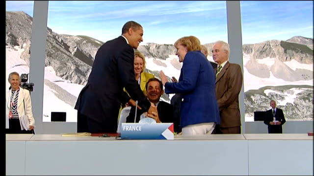president barack obama french president nicholas sarkozy and german chancellor angela merkel chatting and laughing and gathering of g8 leaders seen... - g8 stock-videos und b-roll-filmmaterial