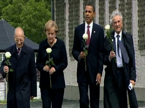 president barack obama german chancellor angela merkel and two second world war veterans walk towards press carrying white roses at buchenwald... - campo di concentramento di buchenwald video stock e b–roll