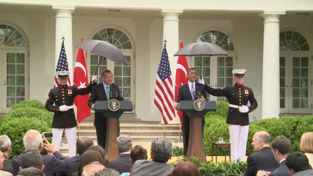 US President Barack Obama gets rained on calls for honor guard Marines to hold umbrellas during press conference with Turkey Prime Minister Tayyip...