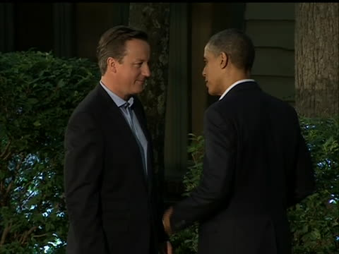 president barack obama greets british prime minister david cameron at camp david before the g8 summit - united states and (politics or government) stock videos & royalty-free footage