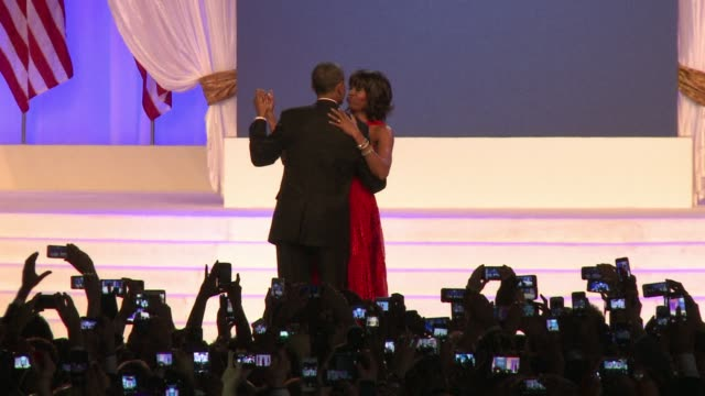 President Barack Obama in a sharp tuxedo held First Lady Michelle Obama close as they slow danced on stage to pop songstress Jennifer Hudson covering...