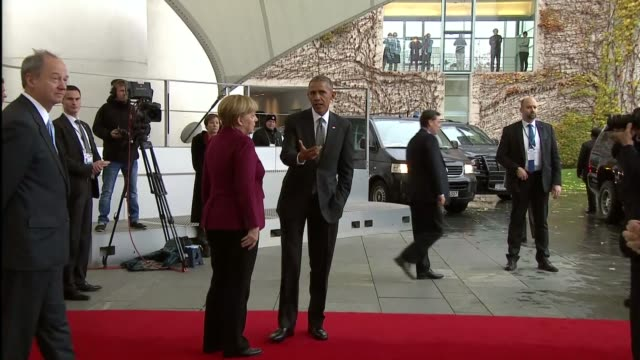 president barack obama is escorted by german chancellor angela merkel as he leaves the german chancellery after meeting with european union leaders... - アンゲラ・メルケル点の映像素材/bロール