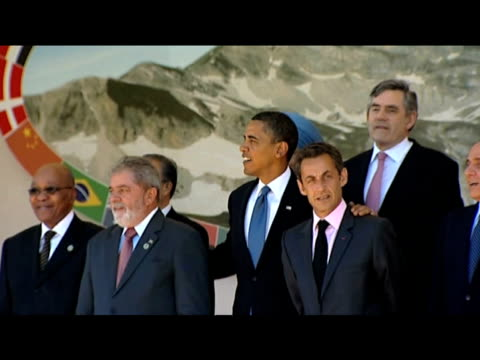 vídeos y material grabado en eventos de stock de president barack obama is last to arrive as leaders of g8 summit wait to pose for group photo italy; 9 july 2009 - number 9