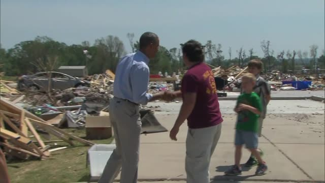 president barack obama met with victims of a tornado and toured the damage in central arkansas on may 7, 2014. - victim stock videos & royalty-free footage