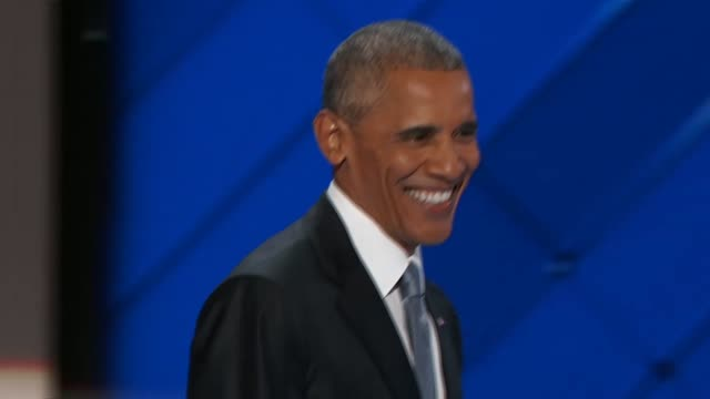 president barack obama on stage at the convention after his speech with presidential nominee hillary clinton as the two wave at delegates and exit... - obama stock videos & royalty-free footage