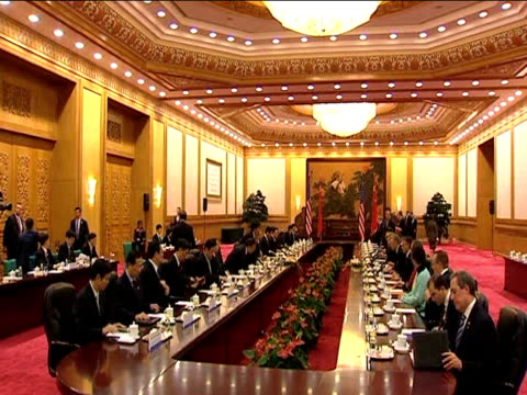 US President Barack Obama sits with Chinese President Hu Jintao at joint conference during his first official tour of Asia since taking up office...
