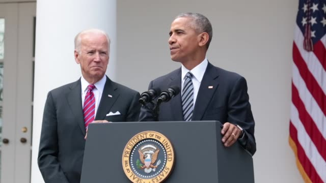 US President Barack Obama speaks as US Vice President Joe Biden stands in the Rose Garden at the White House in Washington DC US on Wednesday Nov 9...