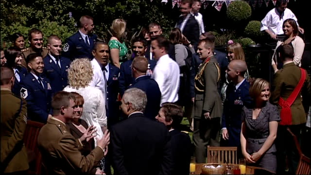 day 2 england london downign street ext various views of barack obama and david cameron cooking hamburgers on barbecues and serving food at event for... - coleslaw stock videos & royalty-free footage