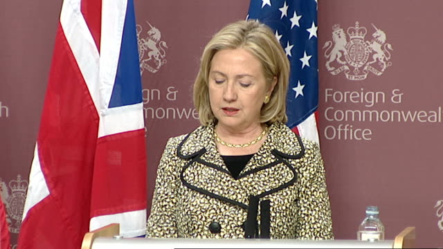 us president barack obama state visit to britain obama arrives day early england london foreign office int hillary clinton press conference sot time... - muammar gaddafi stock videos & royalty-free footage