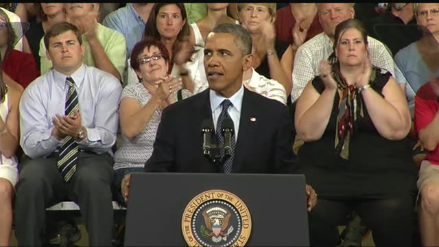 stockvideo's en b-roll-footage met president barack obama talks about the preexisting condition aspect of affordable care act during a 2013 speech about the economy and the middle class - business or economy or employment and labor or financial market or finance or agriculture