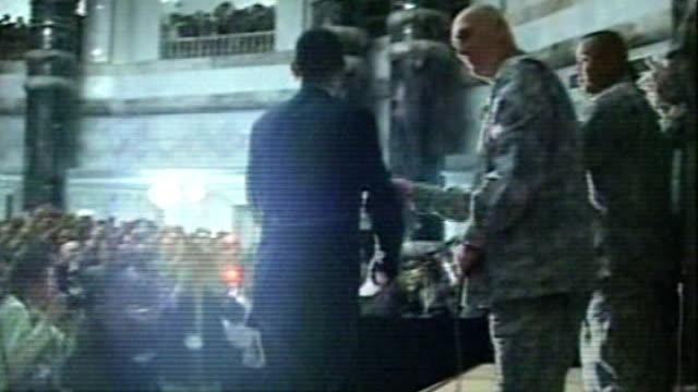 president barack obama visit; iraq: baghdad: int ** warning some flash photography ** us president barack obama along onto stage and addressing us... - iraq stock videos & royalty-free footage
