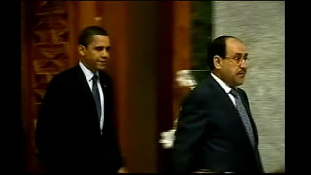 us president barack obama visit obama into room for press conference with iraqi prime minister nouri almaliki - iraqi prime minister stock videos & royalty-free footage