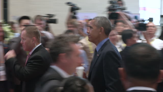us president barack obama walks through the crowd at the association of southeast asian nations summit obama attempted to exorcise some of these... - association of southeast asian nations stock videos & royalty-free footage