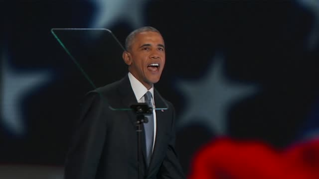 president barack obama was joined by hillary clinton on stage at the convention following the end of his speech the two waving at delegates as they... - 政治集会点の映像素材/bロール
