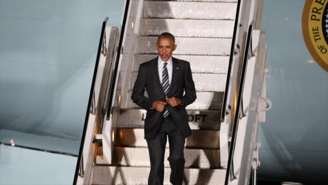 us president barack obama waves before descending from air force one upon his arrival on november 16 2016 in berlin germany president obama is... - air force one stock videos & royalty-free footage