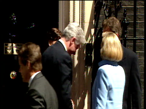 President Bill Clinton and wife Hillary shake hands with Prime Minister Tony Blair and wife Cherie outside 10 Downing Street zoom into to Bill...