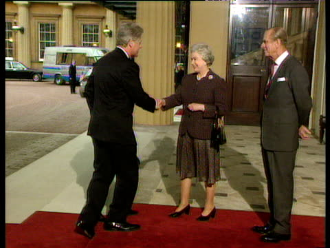President Bill Clinton and wife Hillary shake hands with Queen Elizabeth II and Prince Phillip at Buckingham Palace 29 Nov 95