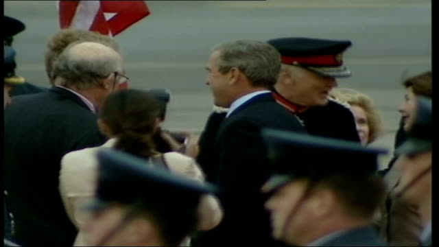president bush in uk for official visit: arrives at brize norton; itn england: oxfordshire: raf brize norton: ext us president george w bush with... - oxfordshire stock videos & royalty-free footage