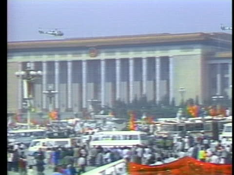 president bush speaks about the protesting students in china as military helicopters fly above tiananmen square. - tiananmen square stock videos & royalty-free footage