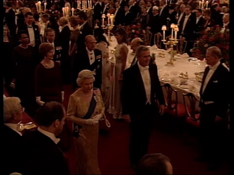 President Bush state visit POOL London Buckingham Palace President George WBush towards along red carpet for banquet with Queen Elizabeth II followed...