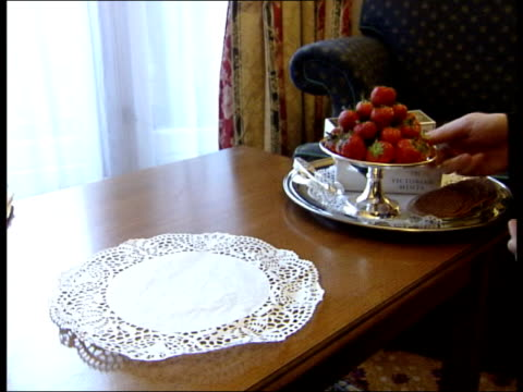mirror journalist breaches palace security itn reconstruction of tray with strawberries and mints laid on table by footman - フットマン点の映像素材/bロール