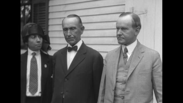 president calvin and first lady grace coolidge alight from car kiss and shake hands with john calvin coolidge sr man holds door open and stands by... - coolidge calvin stock videos & royalty-free footage