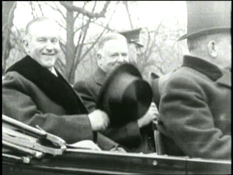 us president calvin coolidge and vice president herbert hoover put on their top hats at the same time while sitting in a convertible - convertible top stock videos & royalty-free footage