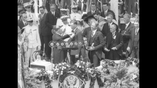 president calvin coolidge awards charles lindbergh with the distinguished flying cross attending dignitaries and naval officers also on podium applaud - charles lindbergh stock videos & royalty-free footage
