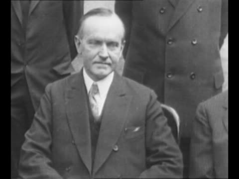 stockvideo's en b-roll-footage met president calvin coolidge / coolidge wears overalls as he stands with two elderly female relatives / cu coolidge in graduation gown / coolidge stands... - afstudeer toga